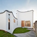 House for a pianist by David Sheppard Architects features fluted outer walls