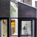 "Norton Ellis extends Georgian basement flat with glass and brick ""outhouses"""