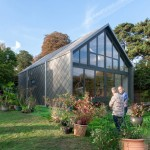 """UK's """"first amphibious house"""" can float on floodwater like a boat in a dock"""