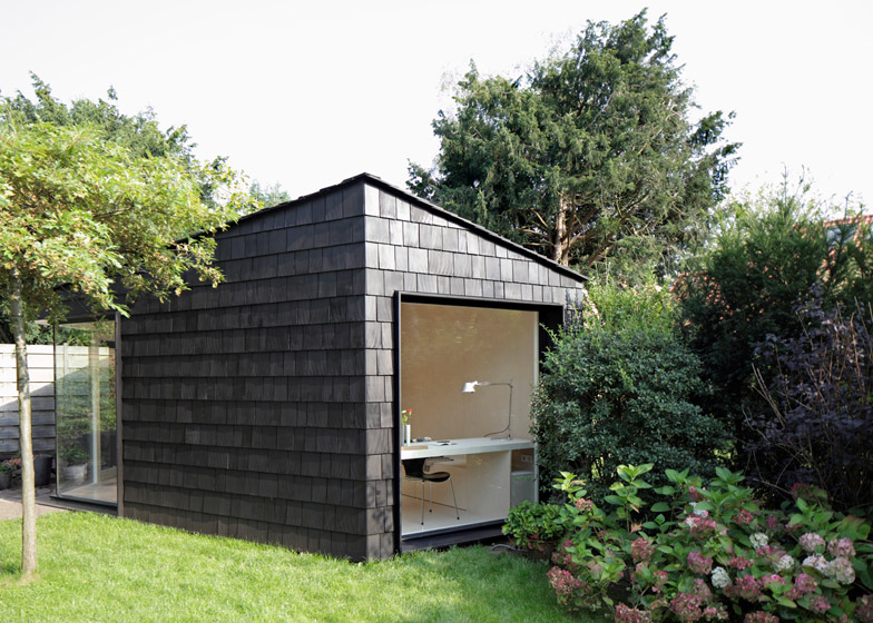 Garden studio by Serge Schoemaker has a dark, rough exterior and a light-filled interior