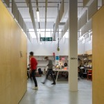 HawkinsBrown uses wooden partitions to turn it into temporary warehouse home for The Bartlett
