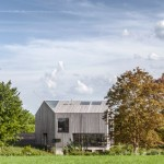 """House in Oxfordshire is covered in oak to create a """"simplified volume"""""""