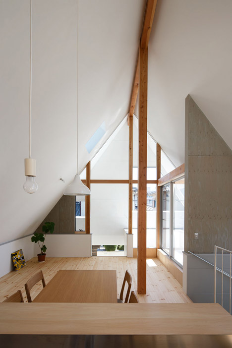 Overhanging Roof Forms A Hood Over Japanese House By Moca
