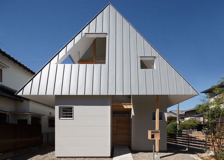 An Overhanging Roof Hoods The Upper Floor Of Moca S Japanese House