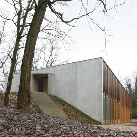 School gymnasium by URA nestles into the landscape at a Belgian school