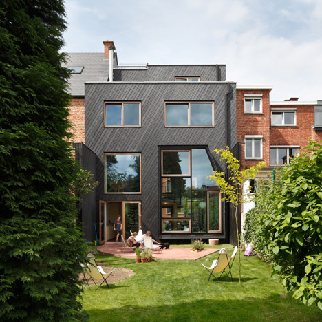 Assorted windows and diagonal cladding feature on renovated home by NU Architectuuratelier