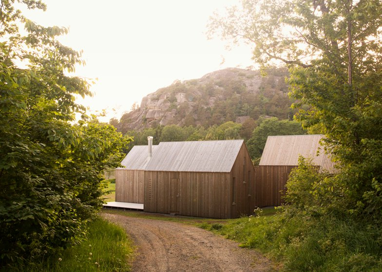 Reiulf Ramstad creates three glass-fronted cabins as Norwegian holiday home
