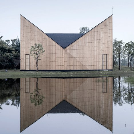 Garden chapel by AZL Architects features<br /> semi-transparent walls and a butterfly roof