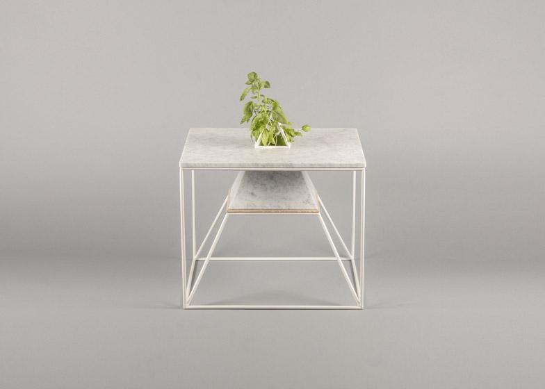 Plants grow inside Maxim Scherbakov's marble Sputnik-5 table