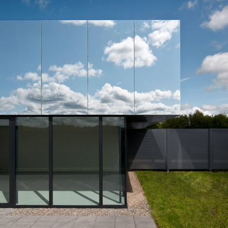 "SATA's medical centre has mirrored ""cloaking"" roof that reflects the sky"