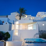 Santorini Island retreat by Kapsimalis Architects features rooftop and underground pools