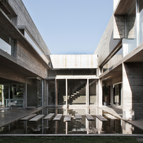 Stepping stones traverse a pool at the centre of this home by BAK Arquitectos