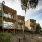 Rough-sawn pine used to build low-cost Hostal Ritoque in Chile