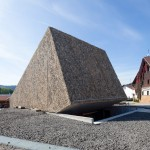 Peter Haimerl's Bavarian concert hall has a rough stone exterior and a raw concrete interior