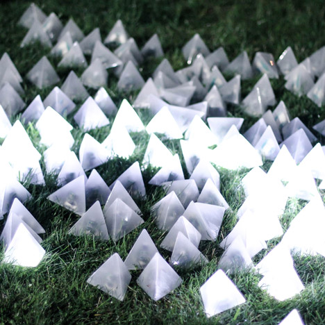 Pangenerator's installation of translucent pyramids flashes in waves of light