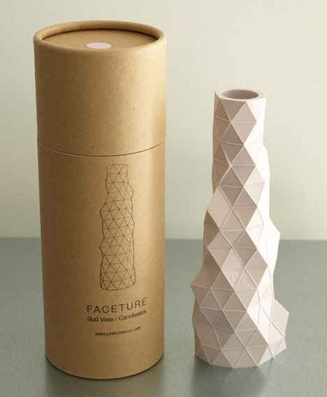 Faceture bud vase/candleholders are packaged in a neat cardboard tube
