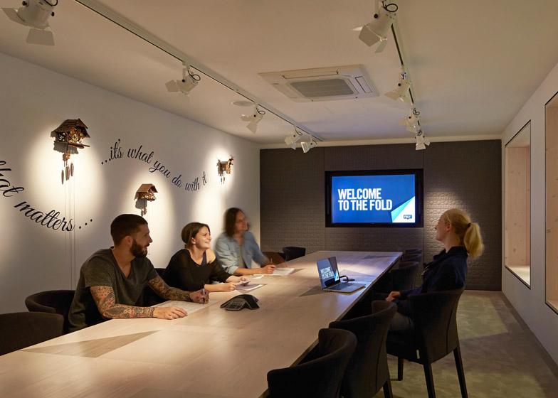 Paul Crofts Studio sinks seating areas into floor of London office