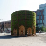Raumlabor builds a grass-covered enclosure around a Montreal fountain