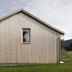 Strips of local spruce clad Haus Feurstein by Innauer‐Matt Architekten