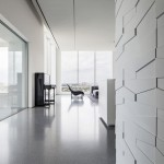 Geometric panels create textured walls inside monochrome penthouse by Pitsou Kedem