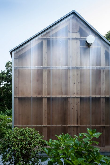 Photography studio by FT Architects features corrugated plastic walls and a faceted roof