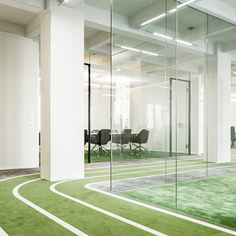 Onefootball HQ by TKEZ features turfed meeting rooms and a running track