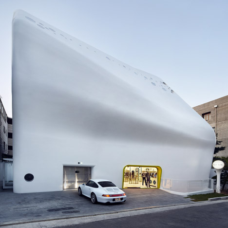 Curving concrete shell encases Paul Smith store by System Lab