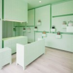 Japanese acupuncture clinic by id inc is lined with mint-green cabinets