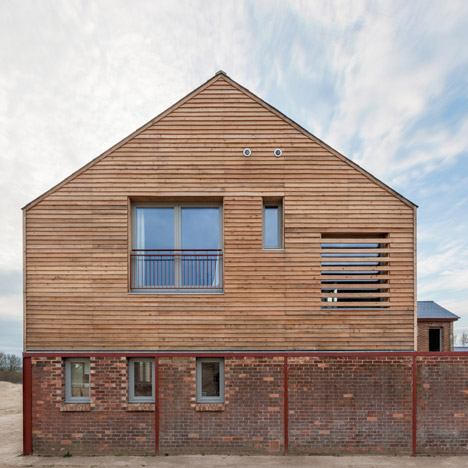 A-Zero turns an English cow shed into a timber-framed family home