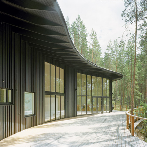 Forest home by Sanaksenaho Architects features black walls and a bean-shaped roof