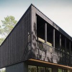 Woodland villa in Sweden designed by Max Holst with a blackened exterior