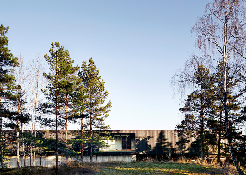White Arkitekter adds a timber and concrete extension to a Japanese-style hotel in Sweden