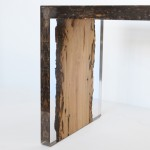 Alcarol uses resin to preserve worm holes in wooden bench