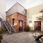Red-brick boiler room converted into tiny guesthouse by Azevedo Design