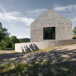 Rural Slovenian cottage by Dekleva Gregorič has walls of stone set into concrete