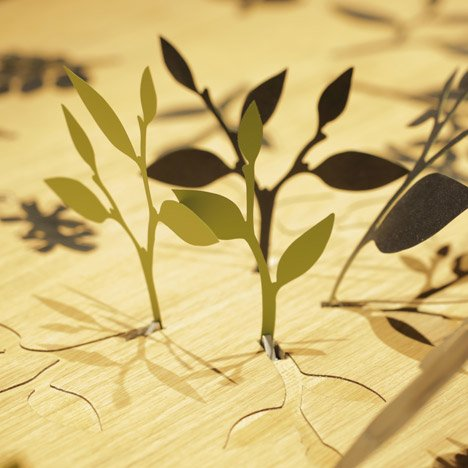 Plants bloom on Mischer'Traxler's table for Perrier-Jouët when you move away from it