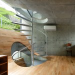 Spiral stairs puncture hilly floors inside Takeshi Hosaka's House in Byobugaura