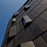 Angled fins flank the windows of KINO Architects' Tokyo apartment block