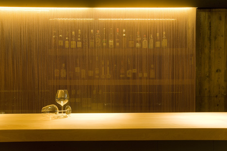 The Coure restaurant in Barcelona displays copper-coloured curtains. LED lighting plays with transparencies