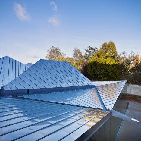 Metallic polygonal roof tops La Madeleine library by Tank Architectes