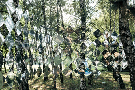 Studio Nomad's mirror installation reflects fragments of forest at a Hungarian music festival