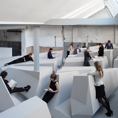 "Conceptual office swaps chairs and desks for ""experimental work landscape"""