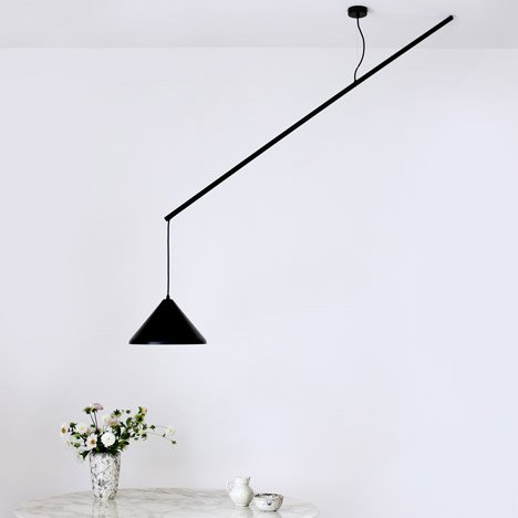 Veronika Gombert's Umleiter lamp hangs offset from its ceiling rose