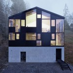 Jochen Specht envelops a 1960s house in a new timber and concrete facade
