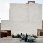 Box House in Kuwait contains a trio of apartments with private courtyards