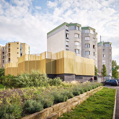 CUT Architectures adds golden walls<br /> to 1960s community centre