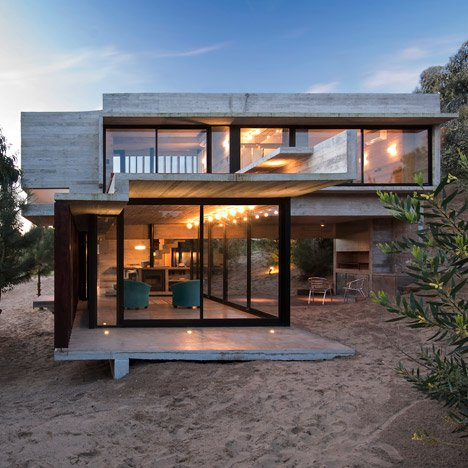 Concrete retreat by Luciano Kruk sits on a sand-dune in Buenos Aires