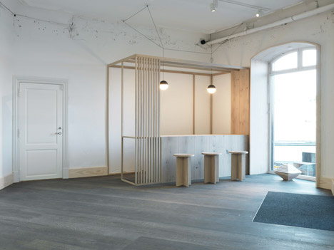 Oeo creates a showroom of two halves for wooden plank manufacturer