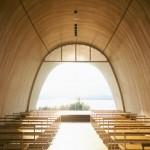 Lakeside hotel by Ryuichi Ashizawa adjoins a wedding chapel with a musical facade