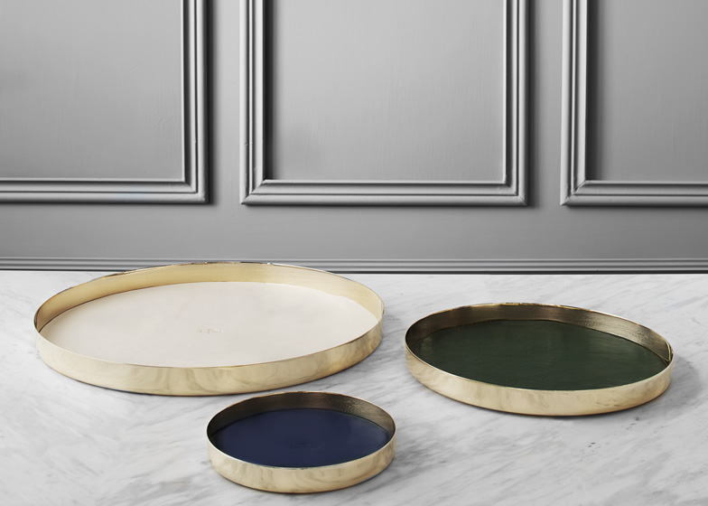 GamFratesi designs leather-lined brass trays for Skultuna